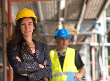 Women in Construction Week - a woman on the job site in a hard hat