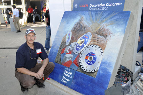 Steven Ochs at Bosch booth with his concrete mural