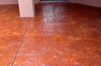 A stamped concrete floor with a solvent-based acrylic that was applied one year ago. The applicator wanted to see what the floor would look like with Armor Blush Repair and Armor AR350 sealer before doing the entire floor.