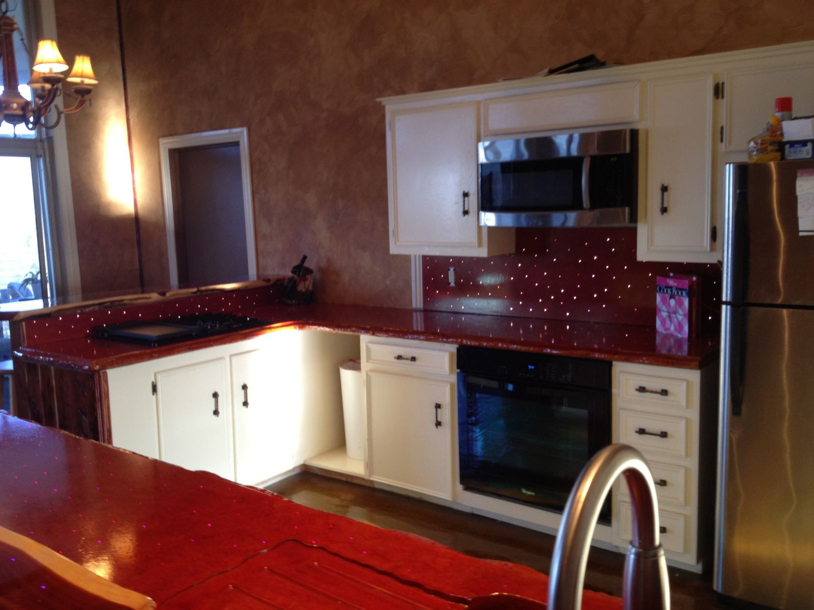 Vibrant red concrete countertops in a kitchen