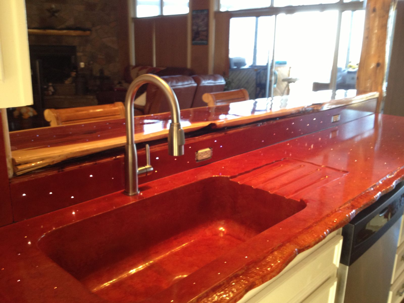 Red kitchen countertops cast in place with LED lights