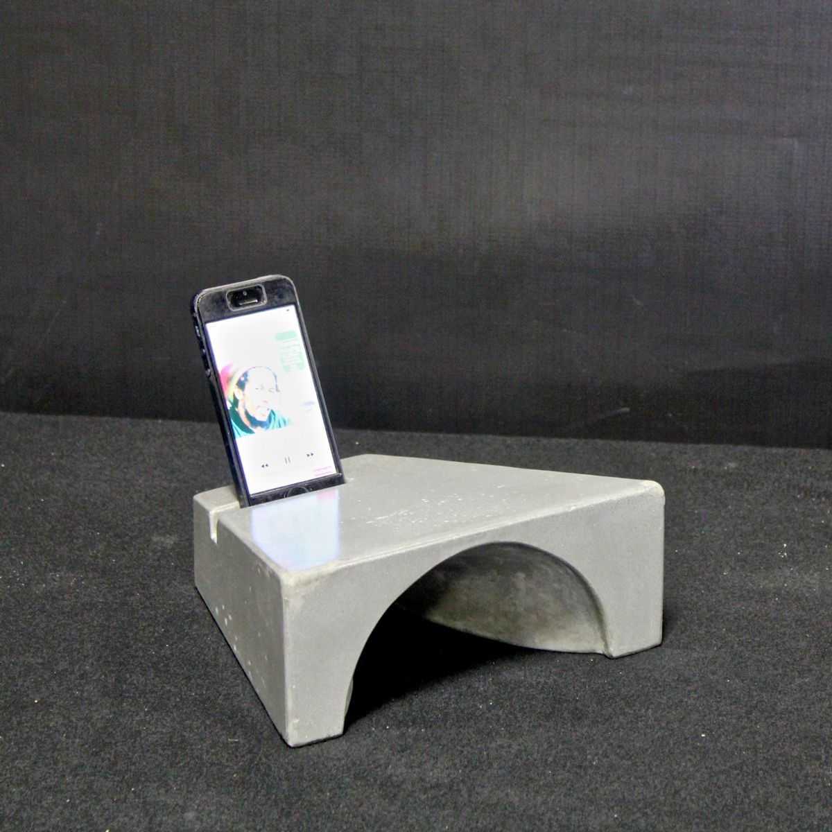 FIRST PLACE Amplif-i Concrete iPhone Dock Jonathan Haywood of Epic Artisan Concrete St Petersburg, Florida The Amplif-i Concrete iPhone dock uses natural acoustic amplification for all generations of iPhone.