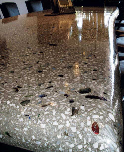 Concrete countertop embedded with glass aggregate and polished for a high sheen.