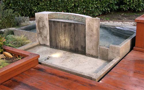 outdoor fountain, poured in place concrete fountain and hot tub.