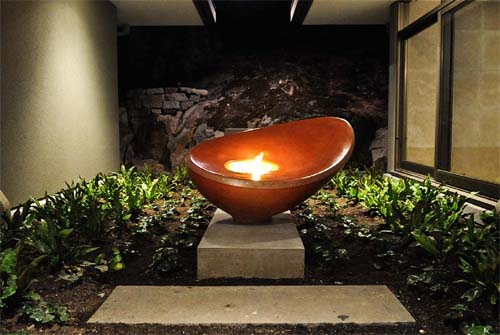 Fire bowl outdoor fire pit, cheng awards, integrally colored concrete fire bowl.