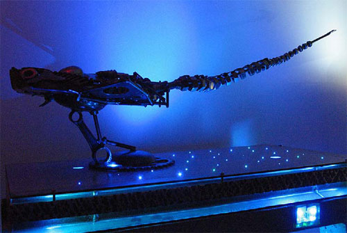 Fiber optics on this countertop illuminate the skeleton of the dinosaur on it.