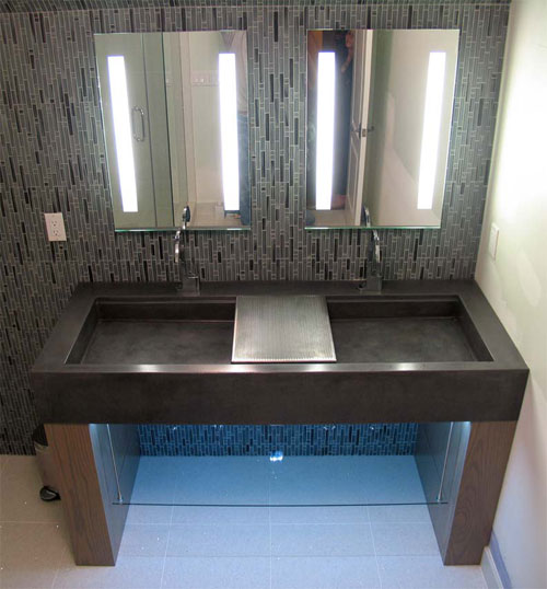 An inexpensive motion sensor can turn on an LED strip light under a sink to create night lighting in a bathroom.