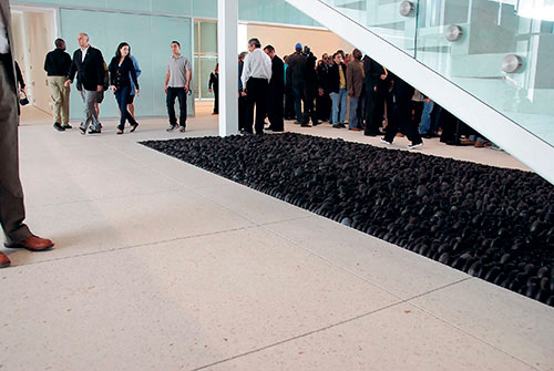 ground the floors down to expose aggregate and honed them using 200-grit resin diamond pads.