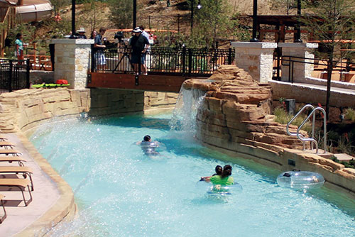 Lazy river winds its way through resort waterpark.