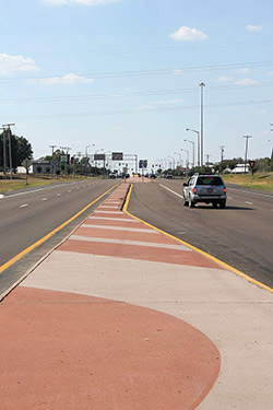 Two toned read and beige color hardener used on median of road.