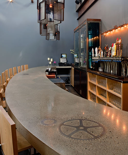 Curved concrete countertop in a busy bar in New England. Gear is placed into the bar top form prior to pouring the concrete.