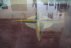Four arrow compass colored into polished concrete floors using dye.