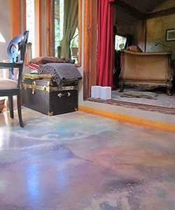 "Thomas McPhee's ""psychedelic"" dyed and overlaid floor. The concretist wonders if there was more acid involved than just the acid in the patina stain."