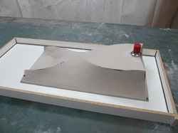 Forming concrete with fabric - If you feel the surface is what you want for a final result, then you are finished. You can place the sink mold into the countertop mold and attach it.