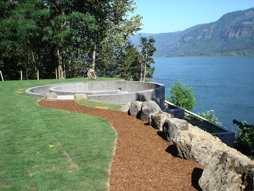 A perfect concrete circle on the water that has been set up for wedding ceremonies.