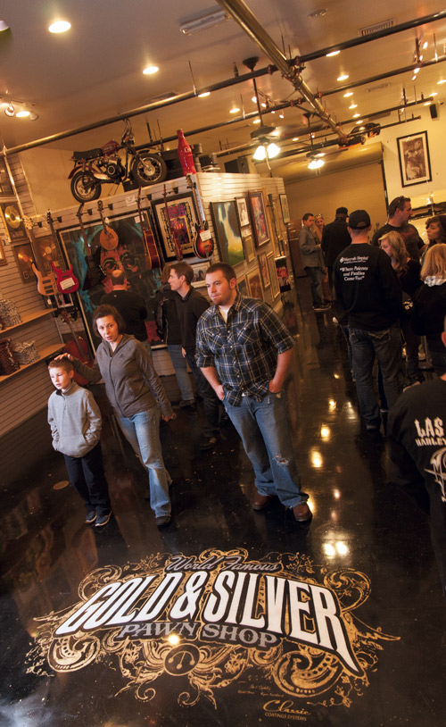 "The black and gold epoxy floor with a gold leaf logo attracts fans and makes the the ""pawn star"" store even more of a destination than it was before"