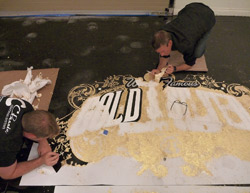 To add a hint of gold sparkle to the floor (it is Las Vegas, after all), they broadcasted gold-foil flakes onto the second coat of black epoxy while it was still wet