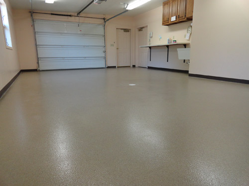 This garage bay at Zwick & Jahn Funeral Home, in Monroeville, Ind., was previously bare concrete that was hard to keep clean and presented a slip hazard when wet. Dancer Concrete, of Fort Wayne, Ind., installed a quartz floor system to solve these problems. Elite Crete Systems products were used. Photos courtesy of Dancer Concrete