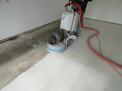 Using a Lavina 20N machine, a Dancer Concrete worker grinds the surface to remove the top layer of cement and contaminants.