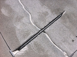 A close up look at the concrete staple installed
