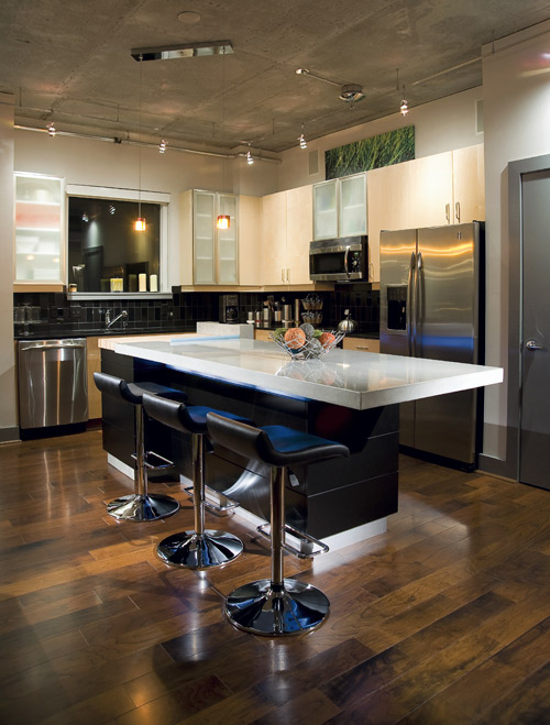 Concrete countertop in a kitchen with a modern look.