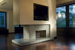 Two sided fireplace in this living room updated with a concrete surround.