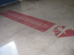 Logo for the Charlotte Rescue Mission dyed onto the concrete slab an polished.