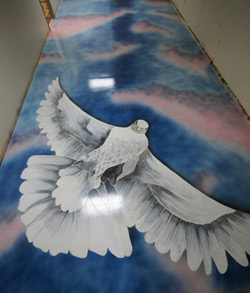A large dove was stained onto the concrete floor to inspire hope.