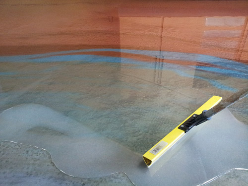 This thick-build 100-percent solids epoxy is being placed with a specialty squeegee to maintain its thickness.