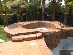 This residential project in Rancho Cucamonga, Calif., included a complete restoration of the rock pool and spa. Kevin Brown of KB Concrete Staining, Mira Loma, Calif., used NewLook materials for the renovation, including the company's SmartColor stain in Milk Chocolate, White, Black and a tan shade.  Photo courtesy of Kevin Brown, KB Concrete Staining