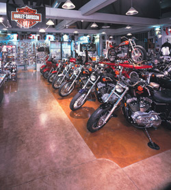 L. M. Scofield Co.'s Chemstain Classic in Faded Terracotta and Black was applied to a white overlay to create vivid light-colored flooring at this Harley Davidson showroom in Glendale, Calif. Photo courtesy of L. M. Scofield Co.
