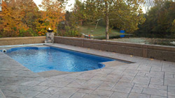 Prior to applying the release and stamping, a light coat of color hardener was broadcast on this pool deck in Danville, Ill., to make its surface less slippery. Photo courtesy of Creative Construction by Design