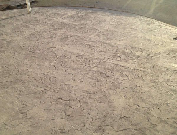Stamped concrete with edges of the texture mat showing