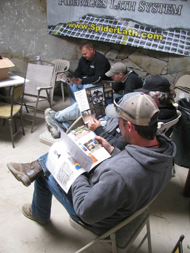 Attendees take a break from learning to read the newest editions of Concrete Decor magazine.