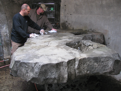 Nathan Giffin and an attendee work to create a concrete countertop.
