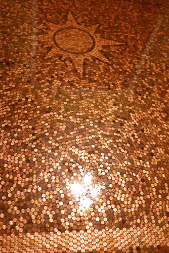 Thorn, of The Concrete Angel, Winfield, Ala., hand-glued 109,730 pennies onto 478 square feet in the Douglasville, Ga., home of Conrad and Elizabeth Beattie.