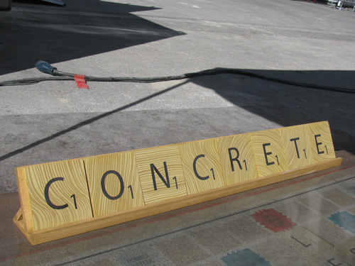 A look at the word concrete made with concrete to look like Scrabble pieces.