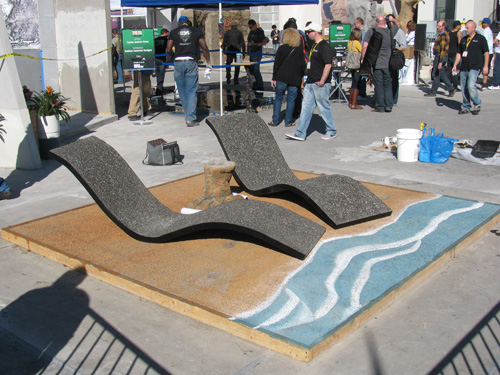 A stamped and stained pervious concrete beach and exposed-aggregate pervious chairs.