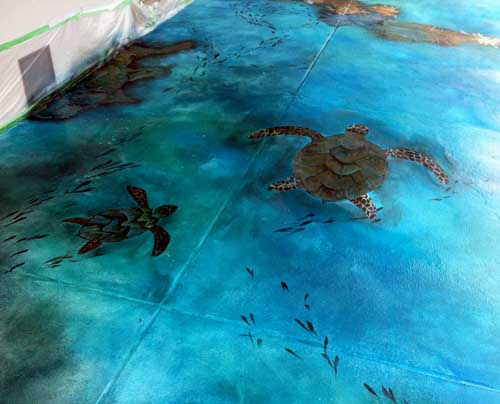 Sea turtles were added onto the concrete floor to make it look like they are swimming.
