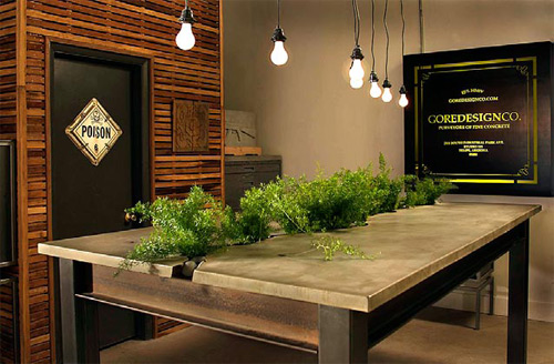 The conference table in Gore's studio is made with custom planters that match his modern style.