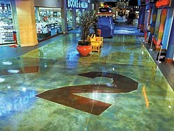 Using acid stains on concrete floors, creating logos and signs is a common site in Las Vegas.