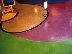 Solid magenta and green colors come alive with concrete stains on classroom floors