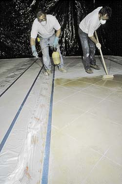 Staining Concrete with personal protection, respirators and gloves. Needed on a concrete construction job site.