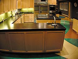Colored concrete countertops can make a statement as does this black concrete countertop.