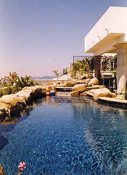 Richard Smith Custom Concrete created a faux rock surrounding a swimming pool on a cliff.