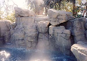Richard Smith Custom Concrete's awesome concrete rock waterfall spilling into a fun filled swimming pool.