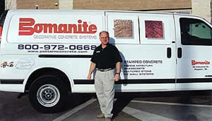 Ira Goldberg, New Jersey Bomanite concrete contractor stands in front of his white van