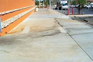 Maintaining decorative Concrete - Sidewalk has water stains and tire black marks that must be clean to preserve the concrete.