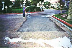 Maintaining Concrete driveways can be a profit center for a concrete contractor. Cleaning a concrete driveway with a swing machine.