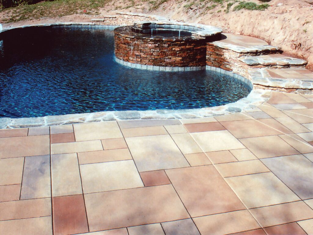 """Bill Guthro of Distinctive Concrete, located in Boston, points out that stamped concrete is also very cost-effective. """"Stamped concrete is usually about one-third less than the price of installing natural materials,"""" according to Guthro."""